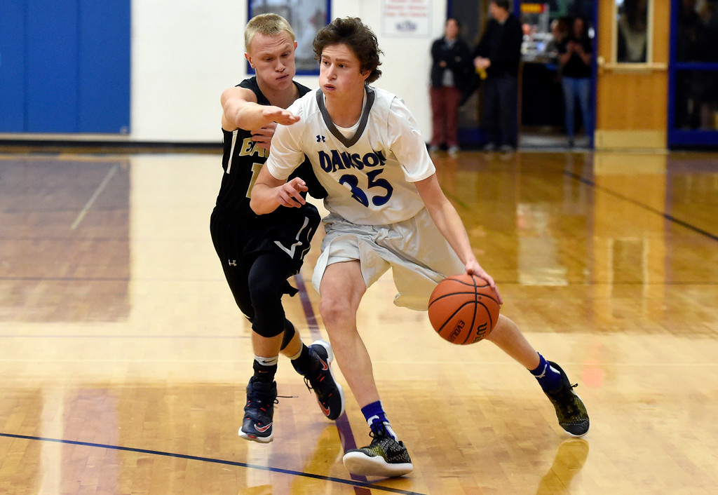 . Alexander Dawson\'s Gavyn Pure dribbles past Charlie Hahm during a game against Rocky Mountain Lutheran High School on Monday in Lafayette. More photos: www.BoCoPreps.com Jeremy Papasso/ Staff Photographer 12/04/2017