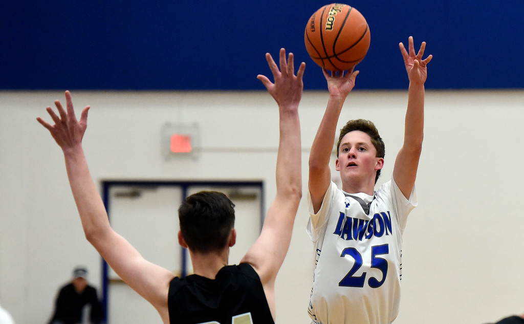. Alexander Dawson\'s Brandon Day takes a shot over Josh Bachicha during a game against Rocky Mountain Lutheran High School on Monday in Lafayette. More photos: www.BoCoPreps.com Jeremy Papasso/ Staff Photographer 12/04/2017