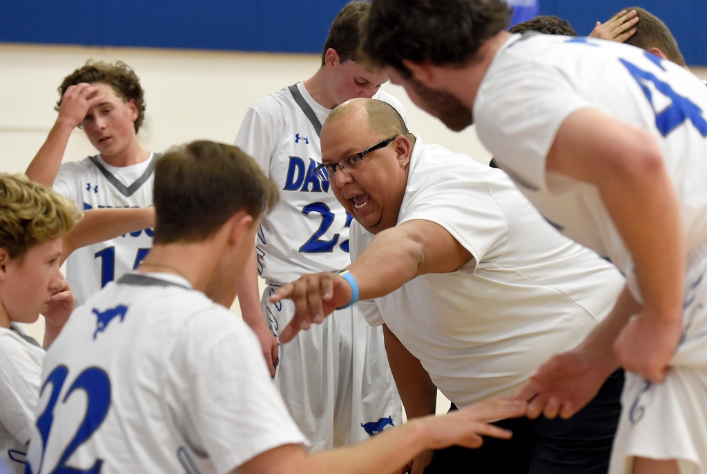 . Alexander Dawson head coach Tobin Skenandore talks with his team during a game against Rocky Mountain Lutheran High School on Monday in Lafayette. More photos: www.BoCoPreps.com Jeremy Papasso/ Staff Photographer 12/04/2017