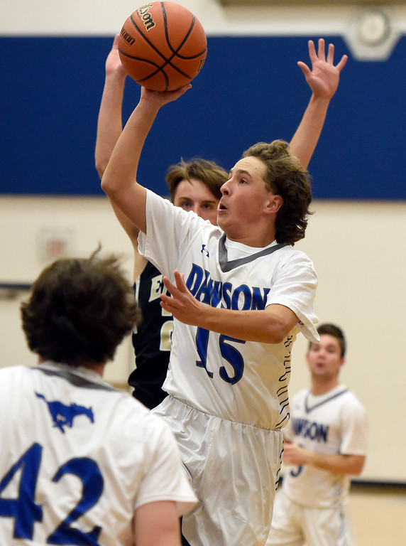 . Alexander Dawson\'s Jordy Grant-Krenz takes a shot during a game against Rocky Mountain Lutheran High School on Monday in Lafayette. More photos: www.BoCoPreps.com Jeremy Papasso/ Staff Photographer 12/04/2017