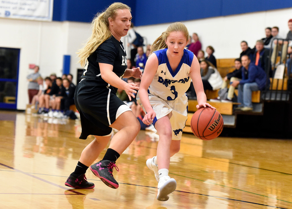 . Alexander Dawson\'s Madison Day dribbles past Maddie Mulvaney during a game against Rocky Mountain Lutheran High School on Monday in Lafayette. More photos: www.BoCoPreps.com Jeremy Papasso/ Staff Photographer 12/04/2017
