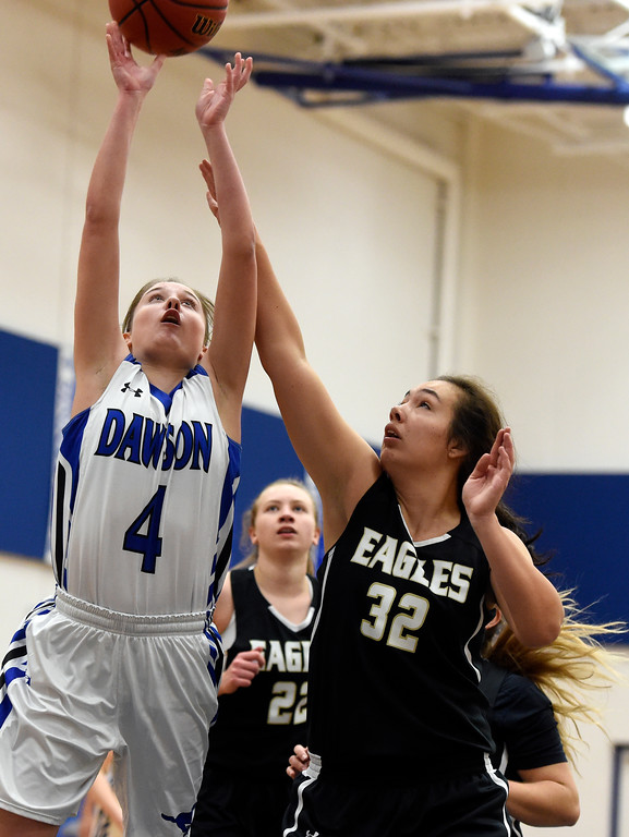 . Alexander Dawson\'s Kaitlyn Day takes a shot over Ashley Larsen during a game against Rocky Mountain Lutheran High School on Monday in Lafayette. More photos: www.BoCoPreps.com Jeremy Papasso/ Staff Photographer 12/04/2017