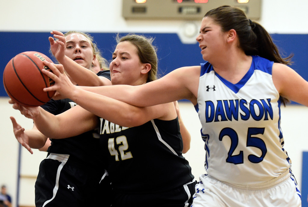 . Alexander Dawson\'s Ruby Walker fights for a rebound with Violet Dumke and Maddie Mulvaney during a game against Rocky Mountain Lutheran High School on Monday in Lafayette. More photos: www.BoCoPreps.com Jeremy Papasso/ Staff Photographer 12/04/2017