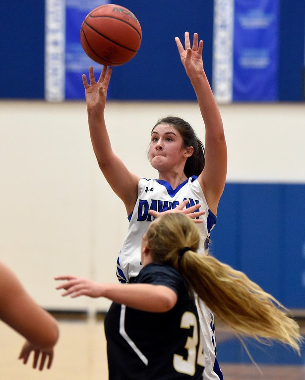 . Alexander Dawson\'s Maddie Timms takes a shot over Maddie Mulvaney during a game against Rocky Mountain Lutheran High School on Monday in Lafayette. More photos: www.BoCoPreps.com Jeremy Papasso/ Staff Photographer 12/04/2017