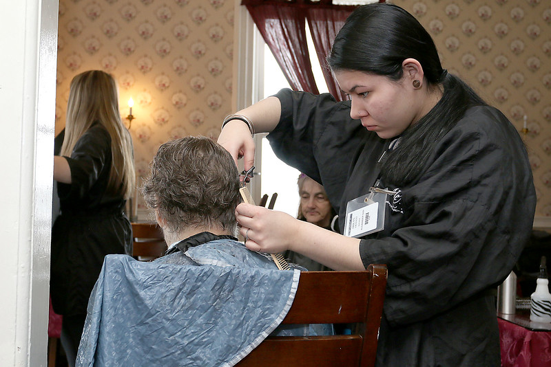 Resident of Village Rest Home Geraldene Collins gets her hair done by Cosmetologist Arilyn Franco from Alexander Academy in Lunenburg on Thursday February 16, 2017. SENTINEL & ENTERPRISE/JOHN LOVE