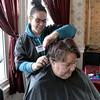 Cosmetologist Hannah Davidson from Alexander Academy in Lunenburg works on Sandy Lee Feltus's hair on Thursday February 16, 2017. Feltus is a resident of Village Rest Home. SENTINEL & ENTERPRISE/JOHN LOVE