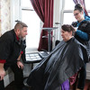 John Shultz from Alexander Academy in Lunenburg chats with Sandy Lee Feltus a resident of Village Rest Home in Leominster as she gets her hair done by Cosmetologist Hannah Davidson from Alexander as well. SENTINEL & ENTERPRISE/JOHN LOVE