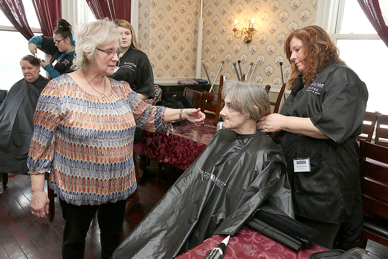 Susan Gariepy RN works with Cosmetologist Lisa Matthews to figure out what to do with Diane Bowne's hair during their visit to Village Rest Home were Bowne lives. SENTINEL & ENTERPRISE/JOHN LOVE