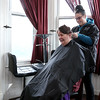 Cosmetologist Hannah Davidson from Alexander Academy in Lunenburg works on Sandy Lee Feltus's hair on Thursday February 16, 2017. Feltus is a resident of Village Rest Home. SENTINEL & ENTERPRISE/JOHN LOVE