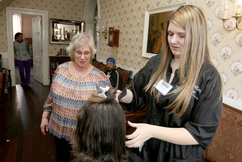 Susan Gariepy RN chats with a resident of Village Rest Home as Cosmetologist Paige Fortin, from Alexander Academy, works during their visit on Thursday February 16, 2017. SENTINEL & ENTERPRISE/JOHN LOVE