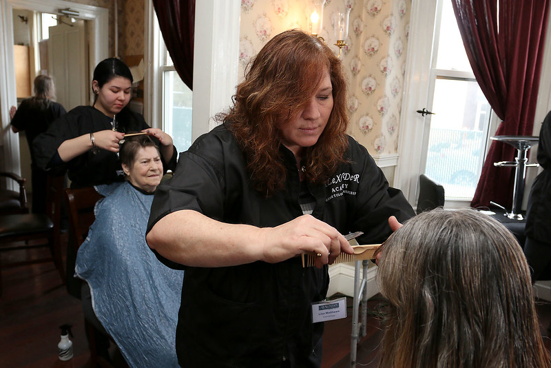 Cosmetologist Lisa Matthews works on Diane Bowne's hair during Alexander Academy's visit to Village Rest Home in Leominster. SENTINEL & ENTERPRISE/JOHN LOVE