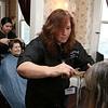Cosmetologist Lisa Matthews works on Diane Bowne's hair during Alexander Academy's visit to Village Rest Home in Leominster. SENTINEL & ENTERPRISE/JOHN LOVE