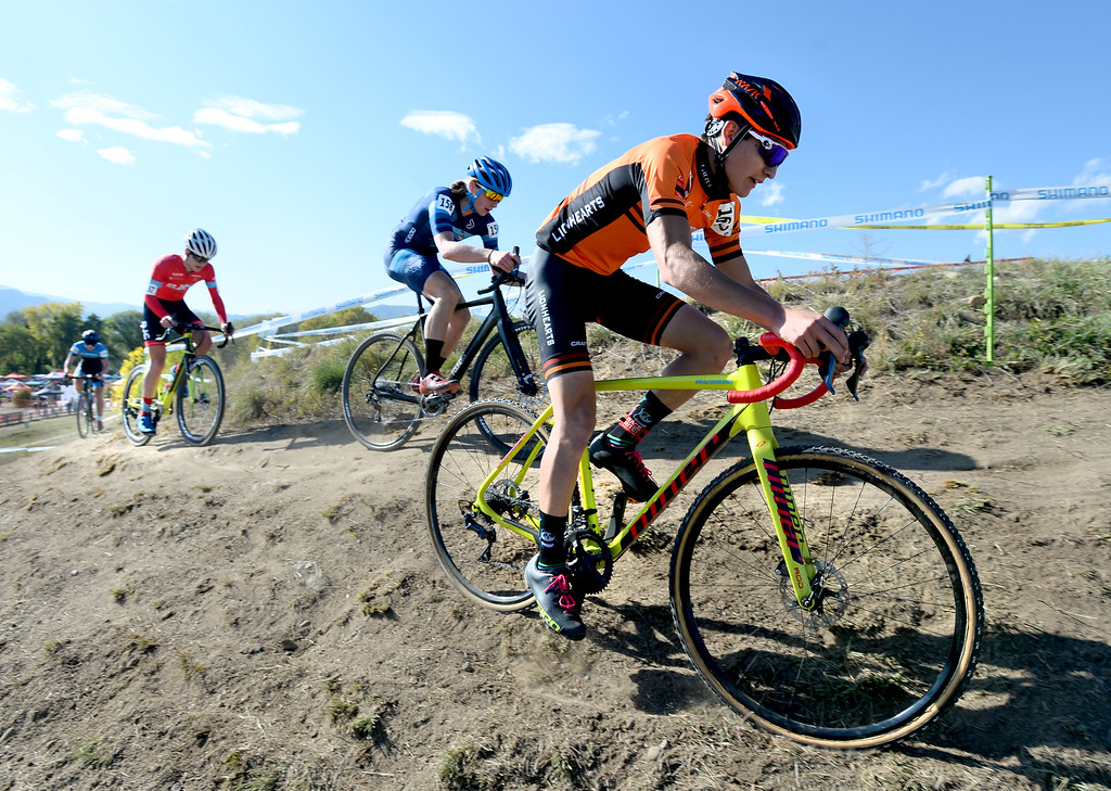 . BOULDER, CO - October 13, 2018: Lucas Stierwalt, right, slides off the course during the Alfalfa�s Eldora US Open cyclocross championship at Valmont Bike Park in Boulder.  (Photo by Cliff Grassmick/Staff Photographer)