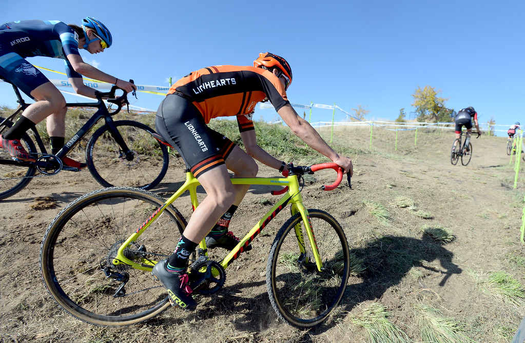 . BOULDER, CO - October 13, 2018: Lucas Stierwalt, center, slides off the courseduring the Alfalfa�s Eldora US Open cyclocross championship at Valmont Bike Park in Boulder.  (Photo by Cliff Grassmick/Staff Photographer)