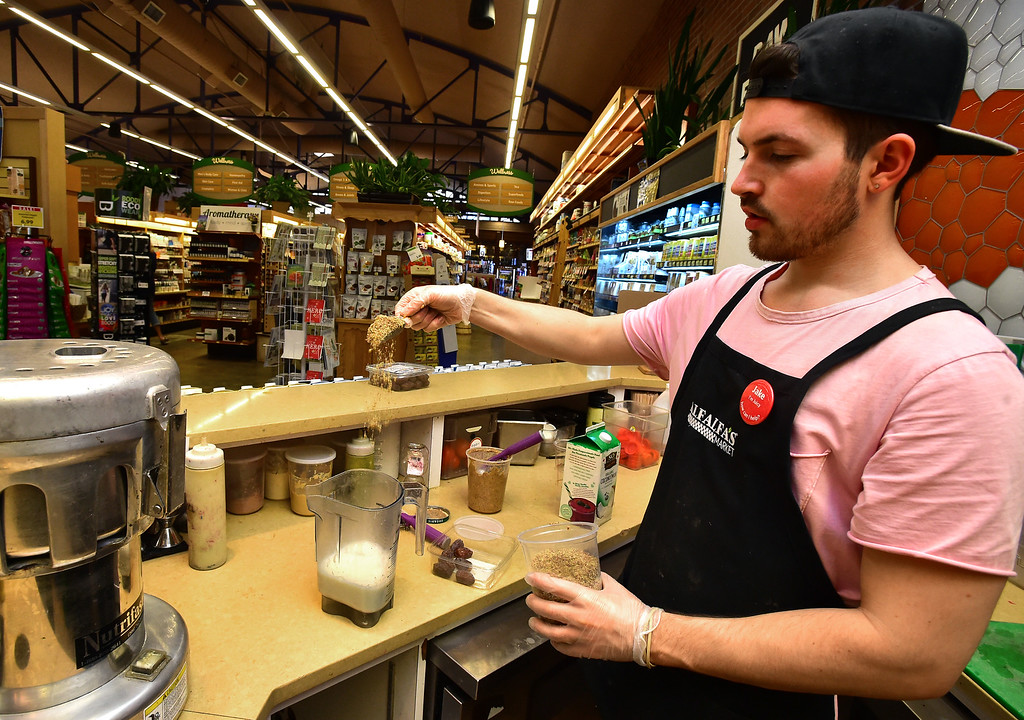 . Jake Mann adds ingredients to a smoothie in the juice bar area in Alfalfa\'s Market in Boulder on Monday. For more photos go to dailycamera.com. Paul Aiken Staff Photographer Nov 13, 2017