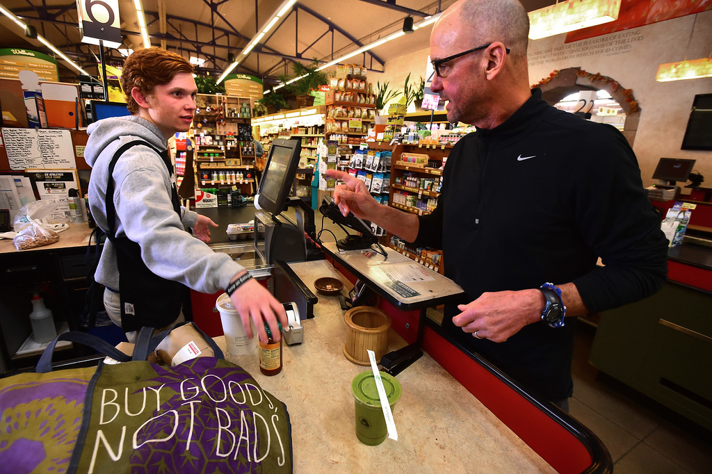 . Customer J. Hill chats with checker Evan Kamlet at Alfalfa\'s Market in Boulder on Monday. For more photos go to dailycamera.com. Paul Aiken Staff Photographer Nov 13, 2017