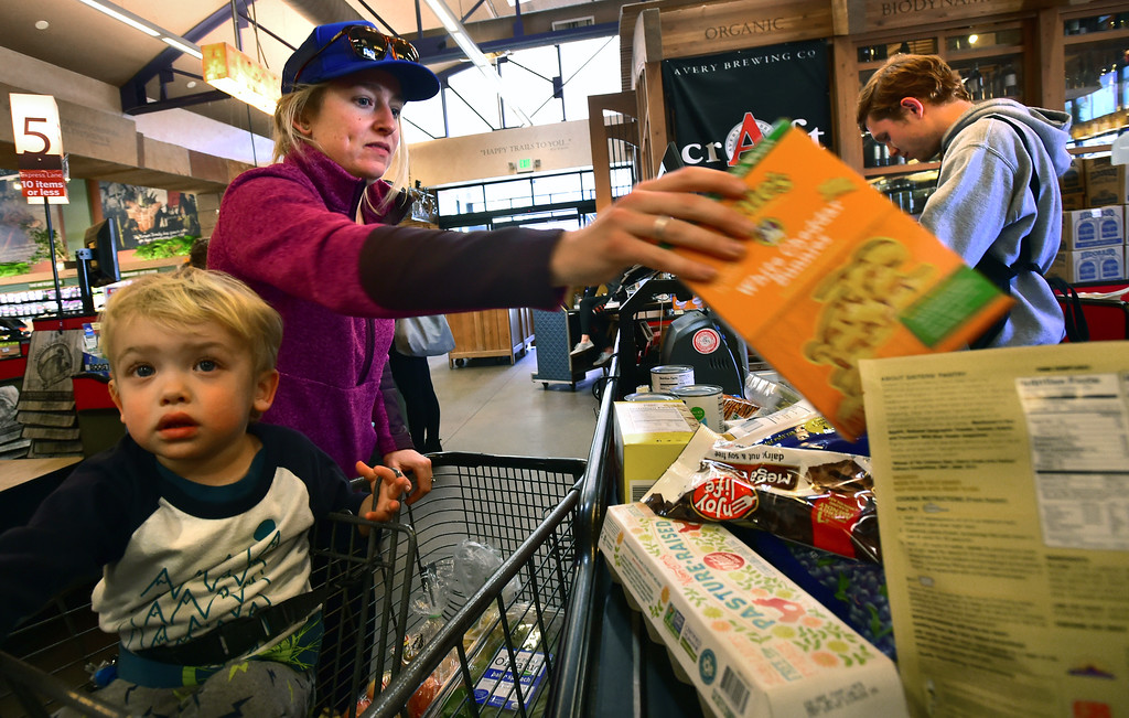 . Joy Larkin puts her groceries on the checkout belt with her son Trey, 2, as checker Evan Kamlet adds up the bill at Alfalfa\'s Market in Boulder on Monday. For more photos go to dailycamera.com. Paul Aiken Staff Photographer Nov 13, 2017