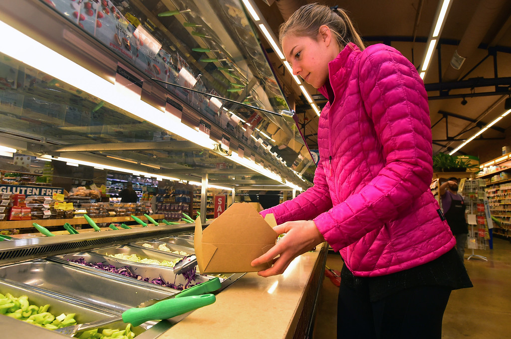 . Carla Moody fills up at the salad bar at Alfalfa\'s Market in Boulder on Monday. For more photos go to dailycamera.com. Paul Aiken Staff Photographer Nov 13, 2017