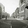 F0972 <br /> Hoofdstraat, gezien vanuit noordelijke richting. Rechts zien we van voor naar achter: het huis van dokter Hueber (later G. Lascaris, nu Blokker), het postkantoor en het KSA-gebouw. Links de winkel  van Melman Herenmode (was vóór 1930 het gemeentehuis) en verderop de toren van de St. Pancratiuskerk. De tramrails zijn al verwijderd. Foto: ca. 1951.