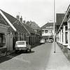 F0575 <br /> Kerklaan in de jaren '60. Links de kruidenierswinkel van Gerrit van Egmond, poelier en ijsverkoper. Alle huizen links zijn in 1975 gesloopt; hotel-café-restaurant 't Bruine Paard aan de Hoofdstraat is in 1979 gesloopt. De huizen aan de rechterkant zijn in november 2001 afgebroken in het kader van het centrumplan; hier is nu het Voorhavenkwartier. Foto: jaren '60.