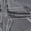 F3560<br /> Een luchtfoto van de Warmonderdam. Van linksboven naar -beneden loopt de A44. Rechts is de DKW-fabriek te zien. Daar tegenover staat het woonwagenkamp.