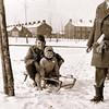 F3726<br /> Winterse opname in de sneeuw genomen op de hoek Parklaan-Molenstraat. Dick en Gerko Wilbrink op slee die door Frank Wilbrink wordt voorgetrokken.