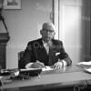 F3647<br /> Burgemeester Jhr. Mr. Rudolph Sandberg van Boelens in zijn werkkamer in het gemeentehuis.