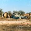 F4267<br /> <br /> Nadat de bebouwing tussen de Kerklaan en de Kastanjelaan was gesloopt, ontstond er een groot leeg terrein. We zien de huizen aan de eind van de Kastanjelaan met uiterst links de oude pandjes van de fam. Witteman. In het midden het pand van Van Velzen.