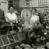 F1567 <br /> De opening van de groente- en fruitwinkel van Jacob Faas op 6 mei 1954. De winkel werd na het overlijden van Jacob Faas voortgezet door zijn medewerker Piet Koning onder de naam 'Fruitfaas'. Het winkelpand is in 2003 gesloopt voor nieuwbouw. Op de foto v.l.n.r.: Piet Koning, mevr. Faas, dochter Riet Faas en Jacob Faas. Foto: 1954.