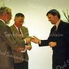 F0597a <br /> Aanbieding van het boekje 'Sassenheim in grootmoeders tijd' aan burgemeester Buddenberg en opname van de tv-krant Centraal Nieuws op het kanaal Holland Centraal. De aanbieding vond plaats in het gemeentehuis van Sassenheim. Foto: 1995.