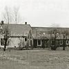F2143<br /> De boerderij van Willem van Rijn, gelegen in het gebied Overteylingen, gefotografeerd vanaf de Carolus Clusiuslaan in april 2001. De boerderij stamt uit de 17de eeuw en was een gemeentelijk monument is. Het heeft een fraai zogenaamd zomerhuis (op de voorgrond).