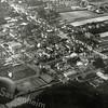 F0885 <br /> Luchtfoto van het centrum van Sassenheim ten noordoosten van de Kerklaan en de Hoofdstraat. De foto is genomen vanuit de zeppelin die  op 6 oktober 1929 over ons dorp voer. Van linksboven naar rechtsonder zien we Hoofdstraat, rechtsboven de Teijlingerlaan en in de linker bovenhoek het Park Rusthoff.