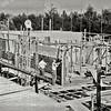 F1025 <br /> Huizen in aanbouw aan de overkant van het kruispunt Willem Warnaarlaan/Parklaan (tegenwoordig de rotonde aan het eind van de Parklaan). In 1959/60 bouwde aannemersbedrijf De Kom deze huizen met plat dak aan de Willem Warnaarlaan/Elbalaan. Architect: Sterrenberg.