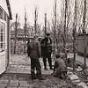 """F3124<br /> Oprichting van het """"Veldhuis"""" door kapelaan Veldthuis.<br /> Dhr. Overmeer heeft het tegelpad gemaakt. De middelste persoon is Kees Hoogeveen. <br /> De kapelaan staat achter de linker persoon."""