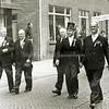 F1802 <br /> De Hoofdstraat te Sassenheim ter hoogte van het huis van Vogelaar. Het Oranjefeest 1958, een deel van het bestuur van de Oranjevereniging. V.l.n.r.: Max van Breda, Cees Melman, Van Vliet, Nic. Demmenie en F. Boot.