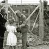 F2826<br /> Opening van de speeltuin D.V.V. op 19 juli 1952. V.l.n.r.: Hein Hoogervorst, meisje is onbekend, burgemeester Sandberg van Boelens en Mies Schipzand-Biere.