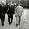 F0664 <br /> Na afloop van een vergadering van de A.R.-Kiesvereniging achter de gereformeerde kerk. Links: ds. F.E. Hoekstra, midden: Jan Schouten ('Maakt geen fouten, stemt Jan Schouten!') en rechts: ds. P.D. Kuiper. Foto: ca. 1947.
