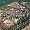 F1939<br /> Een luchtfoto van het AKZO-terrein te Sassenheim, in 1939 alhier gevestigd onder de naam Sikkens' Lakfabrieken. In de rechter bovenhoek zien we de spoorlijn Haarlem-Leiden en in de rechter benedenhoek zien we de A44. Daaronder zien we dat de grond bouwrijp gemaakt wordt voor de bouw van de jeugdgevangenis. In september 2000 werd het Forensisch Centrum Teylingereind geopend.