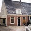 F0391 <br /> Het keurig gerestaureerde pand van de fam. E.P. Audiffred aan Hoofdstraat 127. Vroeger het woonhuis van de fam. P. Moolenaar, die daar een zaadhandel had t.b.v. de groente- en bloementeelt voor eigen gebruik. Rechts staat het huis van J. Moolenaar, dat in 1997 nog in oude staat is. Foto: 1997.