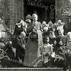 F2755<br /> Mgr. Johannes Petrus Huibers (bisschop van het bisdom Haarlem van 1935 tot 1960) vierde op 14 augustus 1949 zijn 50-jarig priesterfeest. Dit werd o.a. gevierd in huize St. Bernardus, die tevens het 25-jarig bestaan vierde. De bisschop staat op het bordes van de St. Bernardus, met rechts van hem Charley. De zusters zijn van de orde Julie Postel. Zie ook F 1317-2753-2754 en F4393.hem zit pastoor Braak en rechts negertje Charly. Foto: voor 1960