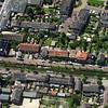 F2346<br /> Luchtfoto van Sassenheim. De Zandsloot loopt van links naar rechts, met aan weerszijden de Zandslootkade en de Postwijkkade. Links de Hoofdstraat.