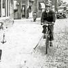 F2974<br /> Kees Posthumus op de fiets in de Hoofdstraat ter hoogte van de Charbonlaan bij het KSA-gebouw. Let op de keitjes (kinderhoofdjes)! Foto vóór 1940.