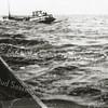 F0883 <br /> Een schuit van Wesseling op het IJsselmeer om voedsel uit Friesland te halen tijdens de laatste oorlogsjaren. Er waren twee schepen: de Sassenheim I en de Sassenheim II. Schipper van de Sassenheim I was Lauw van der Hoorn en de schipper van de Sassenheim II was Tinus van der Hoorn. De foto is genomen door Tinus vanaf de Sassenheim I. Foto: 1944.