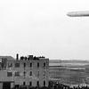 F1455c <br /> De Zeppelin boven Sassenheim ter hoogte van de bollenschuur van Bader (later G.B. de Vroomen). De foto is genomen op 13 oktober 1929.