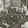 G3068<br /> Handoplegging en zegen tijdens het ziekentriduüm in Huize St. Bernardus met pater Eken. Geheel rechts pastoor Braak. Foto: 1949.