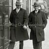 F0954 <br /> Gerrit v.d. Voort met zijn schoonvader Piet Overvliet, wandelend bij de wagenmakerij van Koos Bakker, ter hoogte van waar nu de winkel van Duynstee is. Foto: ca. 1930.