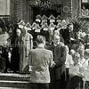 F2753<br /> Mgr. Johannes Petrus Huibers (bisschop van het bisdom Haarlem van 1935 tot 1960) vierde op 14 augustus 1949 zijn 50-jarig priesterfeest. Dit werd o.a. gevierd in huize St. Bernardus, die tevens het 25-jarig bestaan vierde. De bisschop staat op het bordes van de St. Bernardus, met links naast hem pastoor Braak. Geheel links staat kapelaan Blonk. De zusters zijn van de orde Julie Postel. Zie ook F 1317-2754-2755 en F4393.