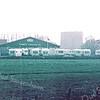 F2629<br /> Caravan- en kampeerbedrijf Campo aan de Teijlingerlaan, voorheen de bollenschuur van C. Wilbrink & Zn. Gezien aan de achterzijde vanaf de Carolus Clusiuslaan. Op de achtergrond de ruïne van Teylingen. Foto: 1978.