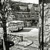 F0183 <br /> Een lijnbus van de N.Z.H. op de Klapbrug. De bus komt van de Teijlingerlaan en draait de Hoofdstraat op, richting Lisse. De Klapburg heette nog wel zo, maar was al jaren geleden van beton gemaakt en verbreed. In de jaren dertig was de brug veel smaller en bedekt met houten planken. Bij ieder voertuig, dat passeerde rammelden de planken. Dit zou de naam 'Klapbrug' verklaren, althans, volgens een hardnekkig verhaaI dat in onze dorpsoverlevering bestaat. Maar 'klapbrug' is ook gewoon een ander woord voor ophaalbrug en van oorsprong wás die daar ook. Foto: eind jaren zestig.