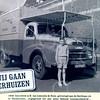 F0728 <br /> Expeditie- en verhuisbedrijf annex meubelopslag Van Leeuwen & Zn., uitgegeven ter gelegenheid van het 80-jarig bestaan van de zaak.<br /> Op de achtergrond de huizen van de fam. van Rijn. Links de aardewerkfabriek Velsen. Foto: 1958.<br /> .